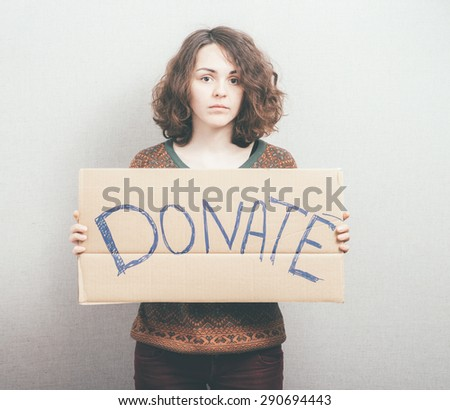 girl holding a sign Donations - stock photo