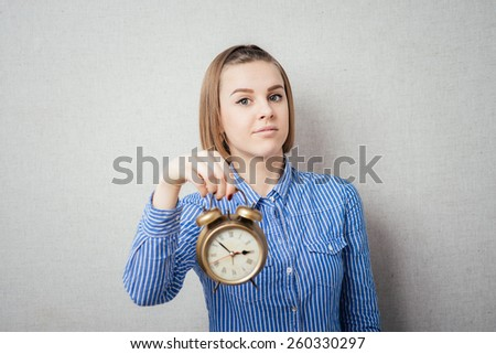 girl holding alarm clock - stock photo
