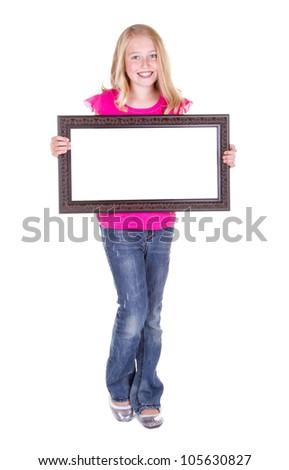 Girl holding blank frame, isolated on white - stock photo