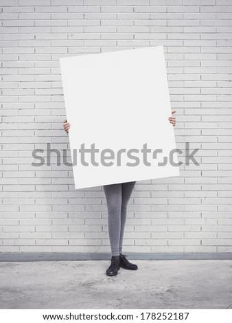 Girl holding blank poster - stock photo