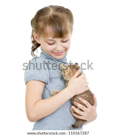 Girl holding British kitten isolated on white - stock photo
