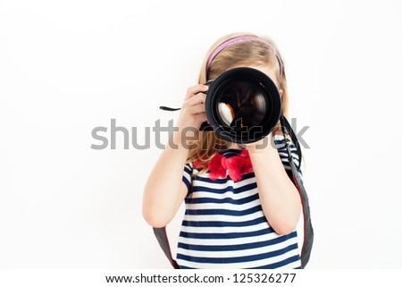 Girl holding Camera and taking photo - stock photo