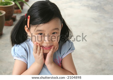 Girl holding chin showing surprised and shocked expression - stock photo