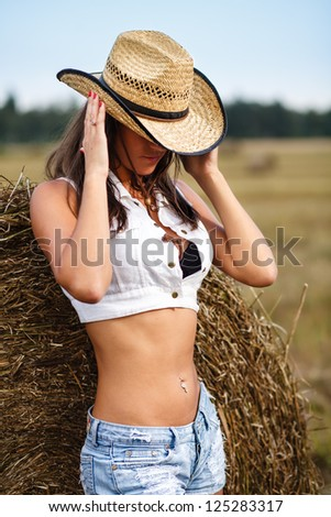 Girl holding cowboy hat. - stock photo