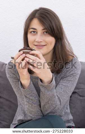 Girl holding cupcake - stock photo
