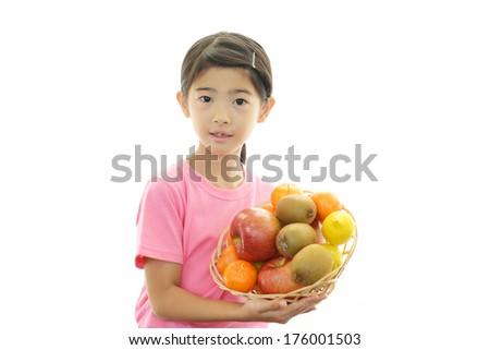 Girl holding fruits isolated on white background  - stock photo