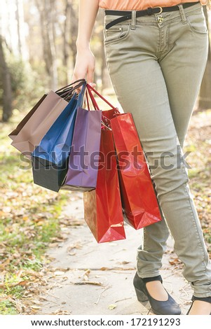 girl holding gift bags - stock photo