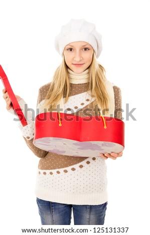 girl holding heart shaped box - stock photo
