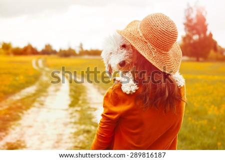 girl holding her funny dog - stock photo