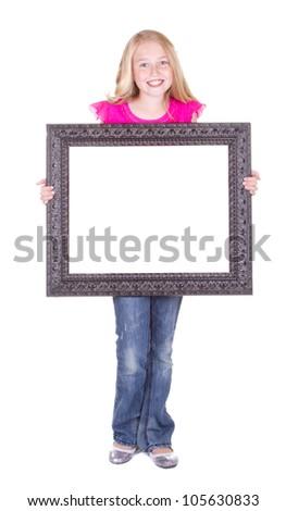 Girl holding large blank frame, isolated on white - stock photo