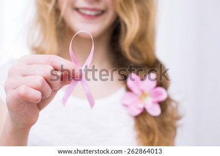 girl  holding pink breast cancer awareness ribbon - stock photo