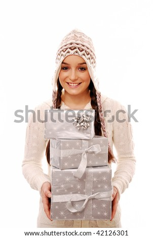 Girl holding stack of presents on white background - stock photo