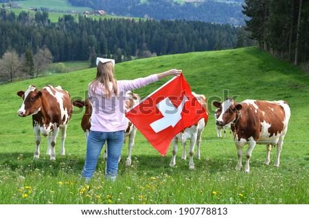 Girl holding Swiss flag. Emmental, Switzerland  - stock photo