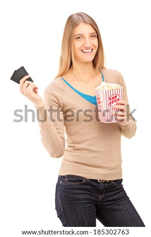Girl holding two movie tickets and box of popcorn isolated on white background - stock photo