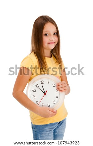 Girl holding wall-clock isolated on white background - stock photo
