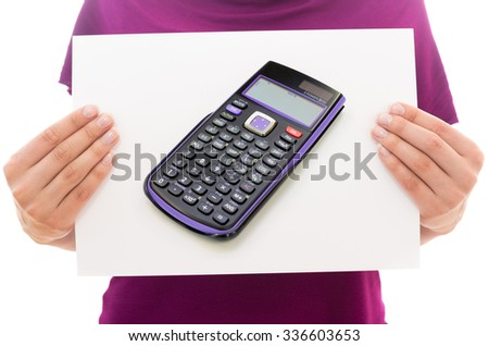 Girl holding white paper sheet with Photo of Scientific calculator - stock photo