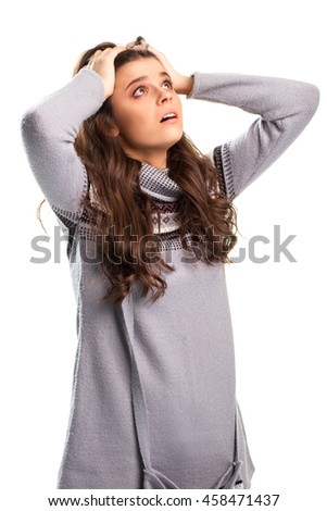 Girl holds head with hands. Black pattern on gray pullover. It's an absolute failure. We lost it all. - stock photo