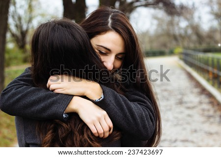 Girl hugging her best friend  - stock photo