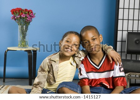 Girl hugging her brother - stock photo