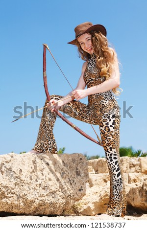 Girl hunting with a bow - stock photo