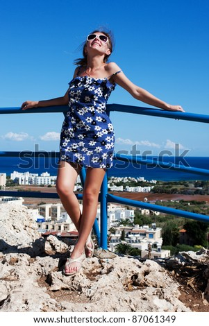 Girl in a beautiful blue dress on top of the hill - stock photo
