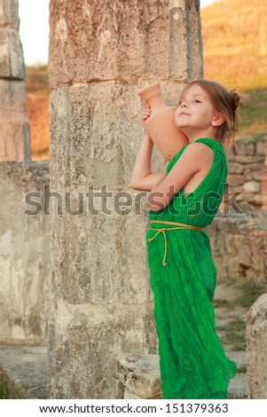 Girl in a beautiful dress with a vintage antique amphora/Excavations on Mount Mithridates city of Kerch, Ukraine - the ruins of the ancient city of Pantikapaion - stock photo