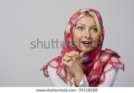 Girl in a beautiful knitted scarf - stock photo