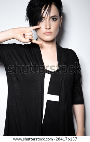 Girl in a black dress with shaved head, art gothic style.  - stock photo