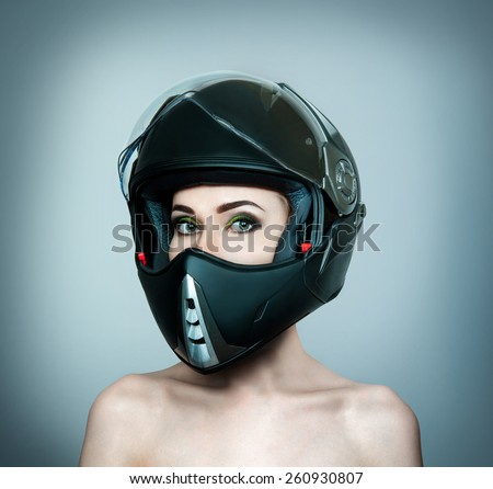 Girl in a black helmet with bare shoulders - stock photo