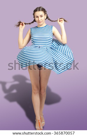 girl in a blue dress. Beautiful woman in fluttering airy blue dress.  - stock photo