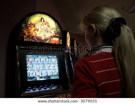 Girl in a casino, playing on a playing automat 2 - stock photo
