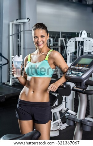 Girl in a fitness center. - stock photo