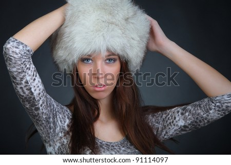 Girl in a fur hat - stock photo