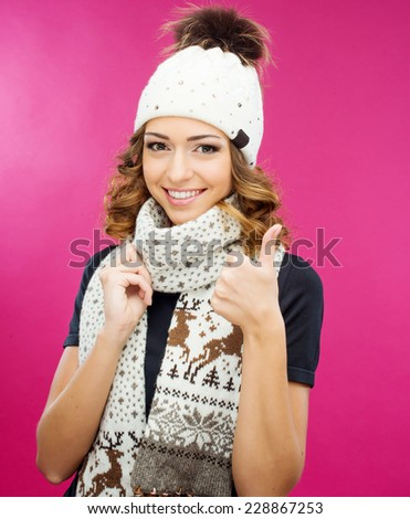 girl in a knitted hat smiling - stock photo