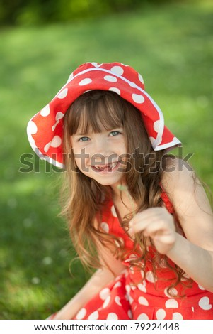 girl in a meadow with dandelion - stock photo