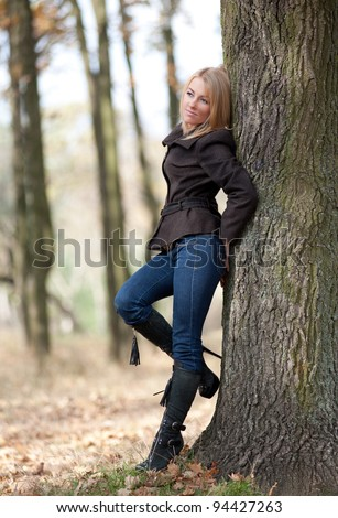 Girl in a park on a autumn-day - stock photo