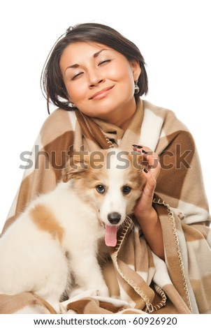 Girl in a plaid with a puppy - stock photo