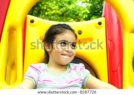 Girl in a Playground - stock photo