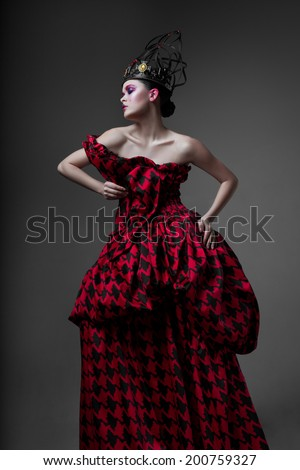 Girl in a red dress and in a crown - stock photo