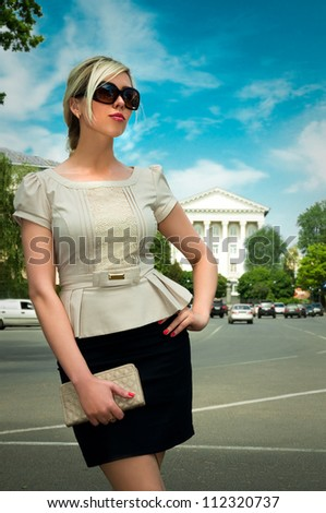 girl in a suit and glasses on the street - stock photo