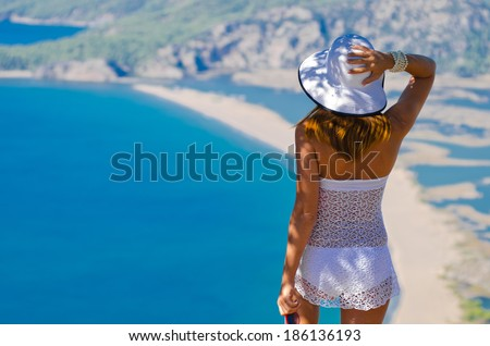 girl in a swimsuit on the mountain and sea views - stock photo