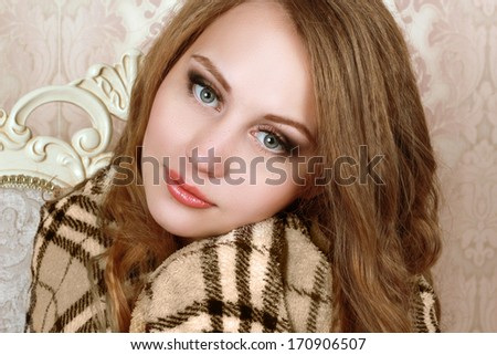 girl in a warm beige plaid - stock photo