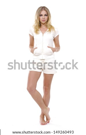 girl in a white shirt and white shorts - stock photo