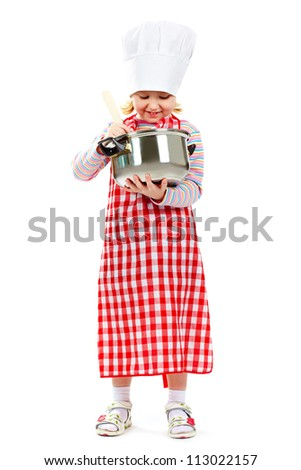 Girl in an apron and cook cap cooking something in pan - stock photo