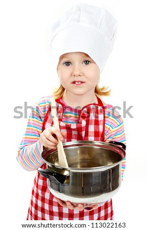 Girl in an apron and cook cap cooking something in pan and looking at camera - stock photo