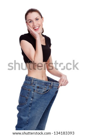 Girl in big jeans. White background - stock photo