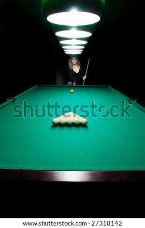 Girl in billiard table - stock photo