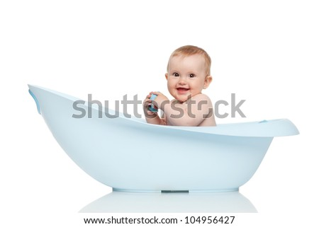 Girl in blue bathtub on white background - stock photo