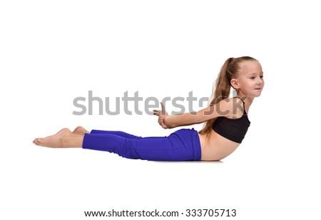 girl in blue clothing doing yoga exercises on a white background - stock photo