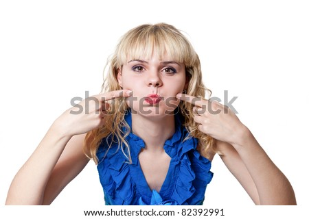 Girl in blue dress funny puffed out his cheeks isolated on white - stock photo